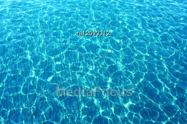 Blue Sea Water With Sunlight Reflections. Stock Photo