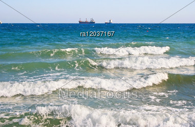 Blue Sea Waves And Ship. Stock Photo