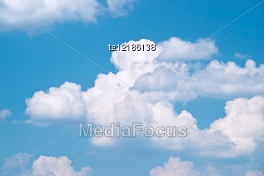 Blue Sky And White Fluffy Clouds, Background Stock Photo