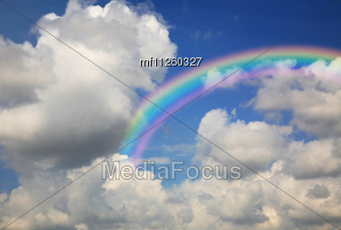 Blue sky with clouds and rainbow Stock Photo