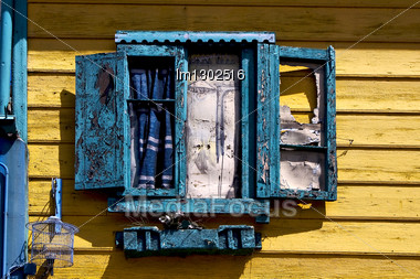 Blue Wood Venetian Blind And A Yellow Wall In La Boca Buenos Aires Argentina Stock Photo