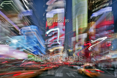 Blur Image Of Times Square In New York City At Night Stock Photo