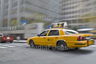 Blurred Nyc Taxi Cab During The Rush Hour In Motion Stock Photo