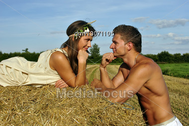Bodybuilder With A Cute Girl In The Countryside Stock Photo