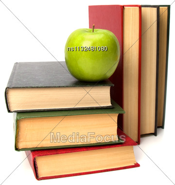 Book Stack With Apple Isolated On White Background Stock Photo