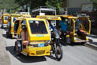 BORACAY, PHILIPPINES - MARCH 04: Tricycle On The Street, March 04, 2013, Boracay, Philippines. Motorized Tricycles Are A Common Means Of Passenger Transport Everywhere In The Philippines Stock Photo