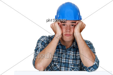 Bored Construction Worker Stock Photo