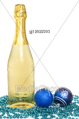 Bottle Of Champagne And Christmas Baubles Over White Background. Stock Photo