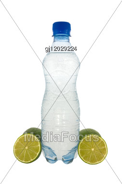 Bottle With Mineral Water And A Green Lemons Stock Photo