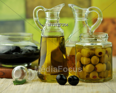 Bottles Of Olive Oil With Black And Green Olives Stock Photo