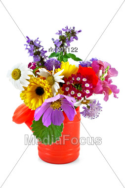 Bouquet Of Flowers In A Red Children's Watering Can Stock Photo