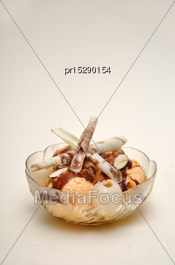Bowl Of Tempting Dessert On A Seamless White Background Stock Photo