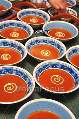 Bowls Of Tomato Soup With Swirls Of Cream And A Sprig Of Parsely Stock Photo