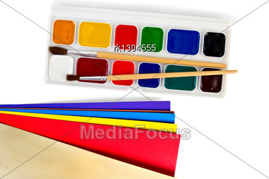 Box Of Paints, Two Brushes, Color Paper Stock Photo