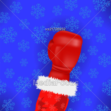 Boxing Santa With Red Glove On Blue Snowflake Background Stock Photo