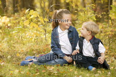 Boy And Girl Hanging Out Together Stock Photo