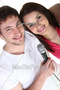 Boy And Girl Singing Stock Photo