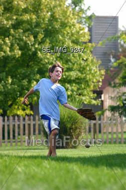 Boy Catching Baseball Stock Photo