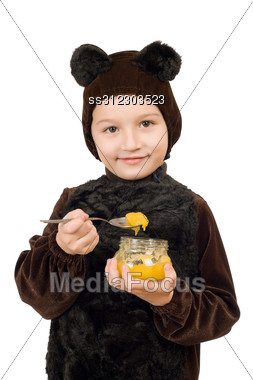Boy Dressed As Bear With A Jar Of Honey. Stock Photo