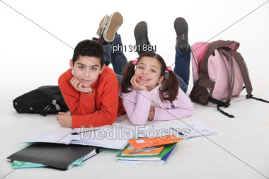 Boy And Girl Doing Their Homework After School Stock Photo