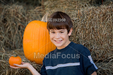 Boy Holding a Little Pumpkin Stock Photo