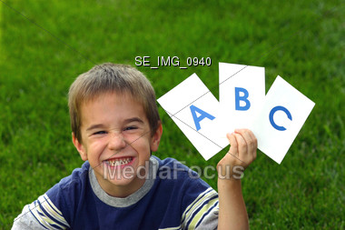 Boy Holding ABC Stock Photo
