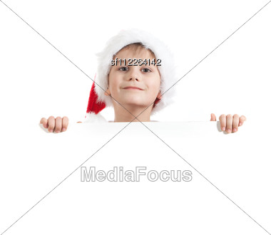 Boy Holding A Christmas Poster Stock Photo