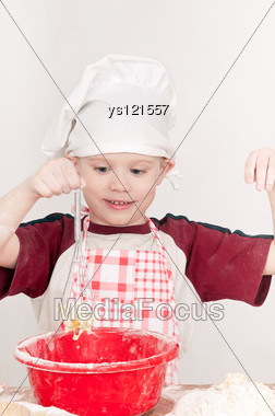 Boy In Chef Hat Knead The Dough Stock Photo