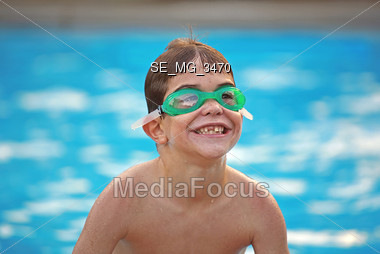 Boy in the Pool Smiling Stock Photo