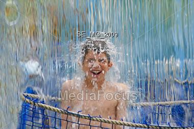 Boy in Waterfall Stock Photo