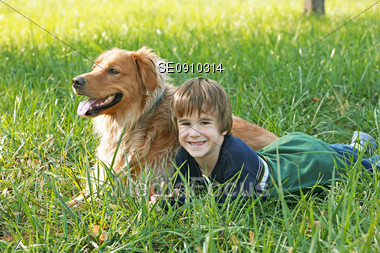 Boy Laying Down with His Dog Stock Photo