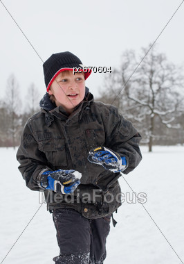 Boy Outside In The Snow Stock Photo