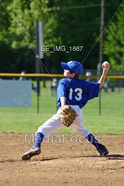 Boy Pitcher Stock Photo
