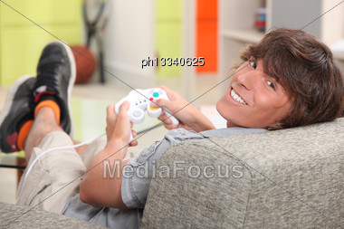 Boy Playing Computer Games Stock Photo