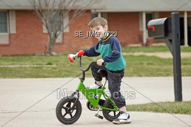 Boy Riding Bike Stock Photo