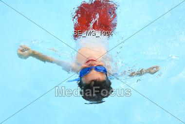 Boy Swimming Stock Photo