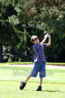 Boy Swinging Club Stock Photo