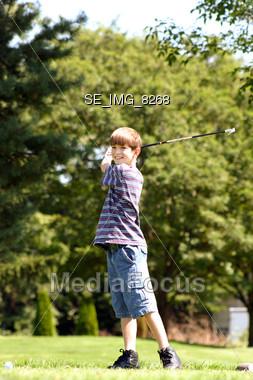 Boy Swinging Club Smiling Stock Photo