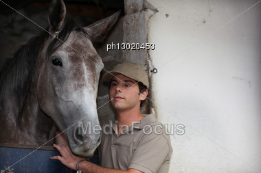 Boy Taking Care Of His Horse Stock Photo