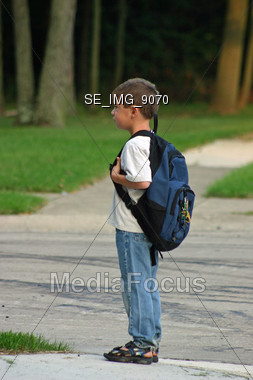 Boy Waiting on Bus Stock Photo