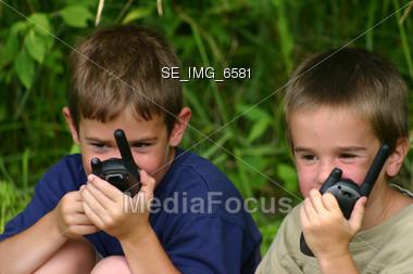 Boys on Walkie Talkies Stock Photo