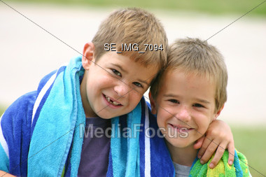 Boys With Beach Towels Stock Photo