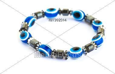 Bracelet With Blue Eyes Isolated On White Background. Stock Photo