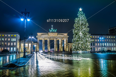 BRANDENBURG GATE, Berlin, Germany At Night. Road Side View Stock Photo