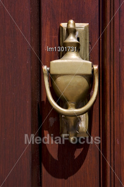 Brass Brown Knocker And Wood Door Colonia Del Sacramento Uruguay Stock Photo
