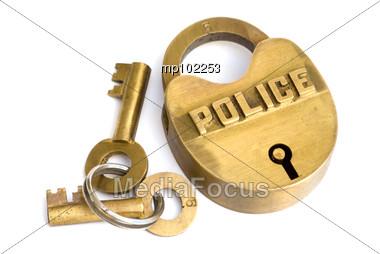 Brass police logo lock and keys to left Stock Photo