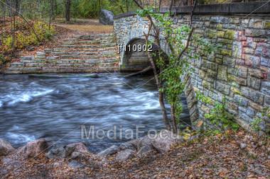 Brick River Bridge And Running Water In Hdr Stock Photo