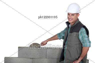Bricklayer Building A Block Wall Stock Photo
