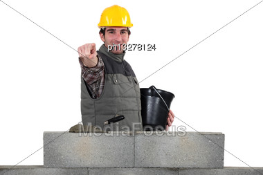 Bricklayer Pointing Ahead Stock Photo