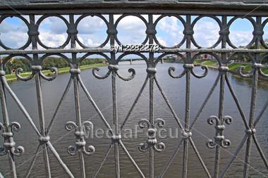 Bridge Banisters Through Greater River Stock Photo